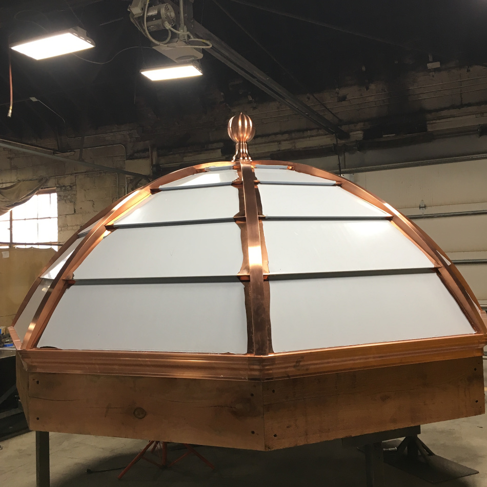 This copper cupola wraps a steel substructure and mounts to wooden beams.  You see only copper inside and out, a visual masterpiece that will only grow in beauty.